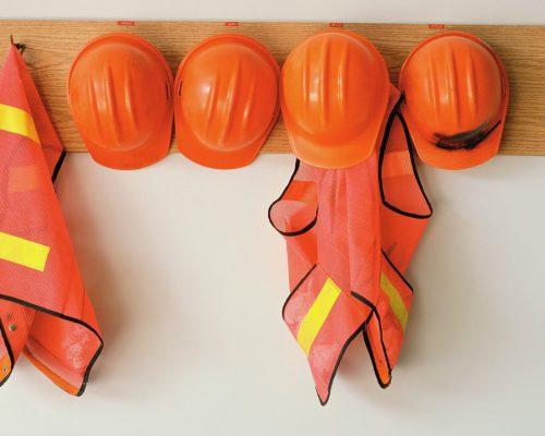 Orange Hard Hats and Safety Vests --- Image by © Patrick Barta/Corbis